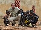 An Austrian officer with children in Mali. (Image opens in new window)
